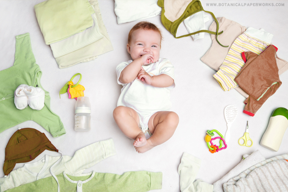 new baby with baby care items