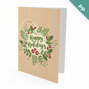 Brimming with greenery and holiday charm, these Happy Holidays Ornament Business Holiday Cards have a beautiful seed paper ornament attached that will grow wildflowers when planted.