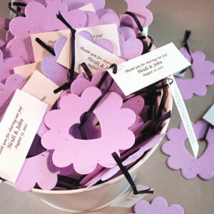 These Bucket of Love Flower Seed Wedding Favors will grow a blend of wildflowers right out of the paper!
