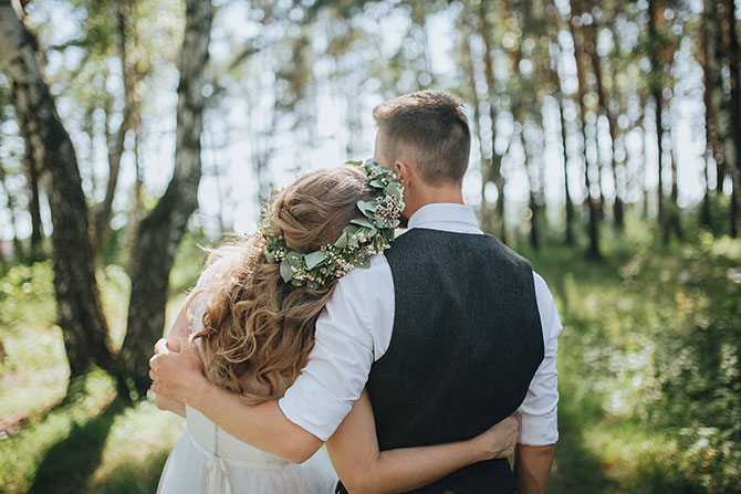 bride and groom with their arms around each other