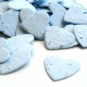 When thrown outside, this heart shaped biodegradable confetti in blue will grow wildflowers.
