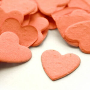 This heart shaped biodegradable confetti in coral makes a great addition to any table decoration.