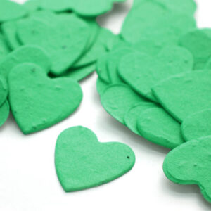When thrown outside, this heart shaped biodegradable confetti in emerald green will grow wildflowers.