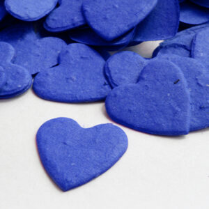When planted, this heart shaped biodegradable confetti in royal blue will grow wildflowers.
