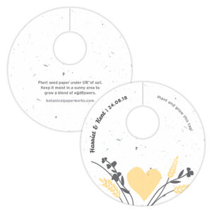 Made with recycled materials and embedded with wildflower seeds, these Prairie Love Plantable Wine Glass Tags include planting instructions on the back so guests can take them home to grow a blooming memento of your rustic country wedding.