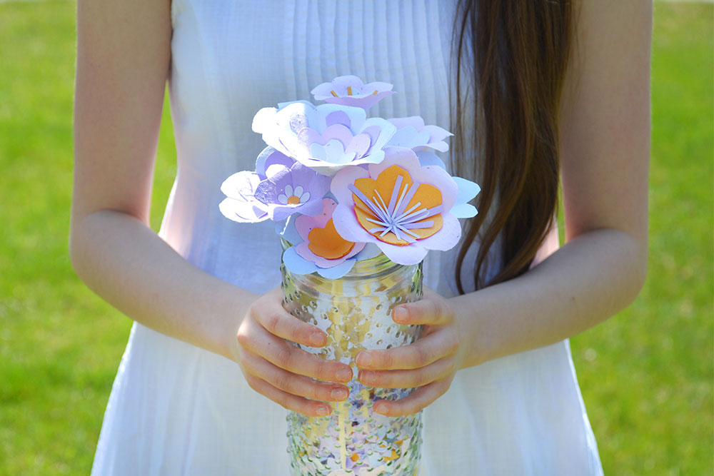 girl holding plantable seed paper flower bouquet