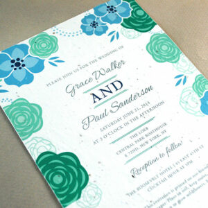 Blooming florals adorn this seed paper wedding invitation that grows REAL flowers!