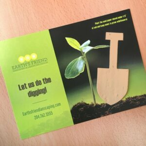 Add-your-logo, custom message, and contact details to the pre-designed template featuring a plantable shovel shape.