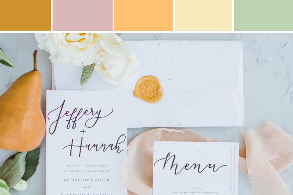 Custom seed paper wedding stationery flat lay with hand render calligraphy