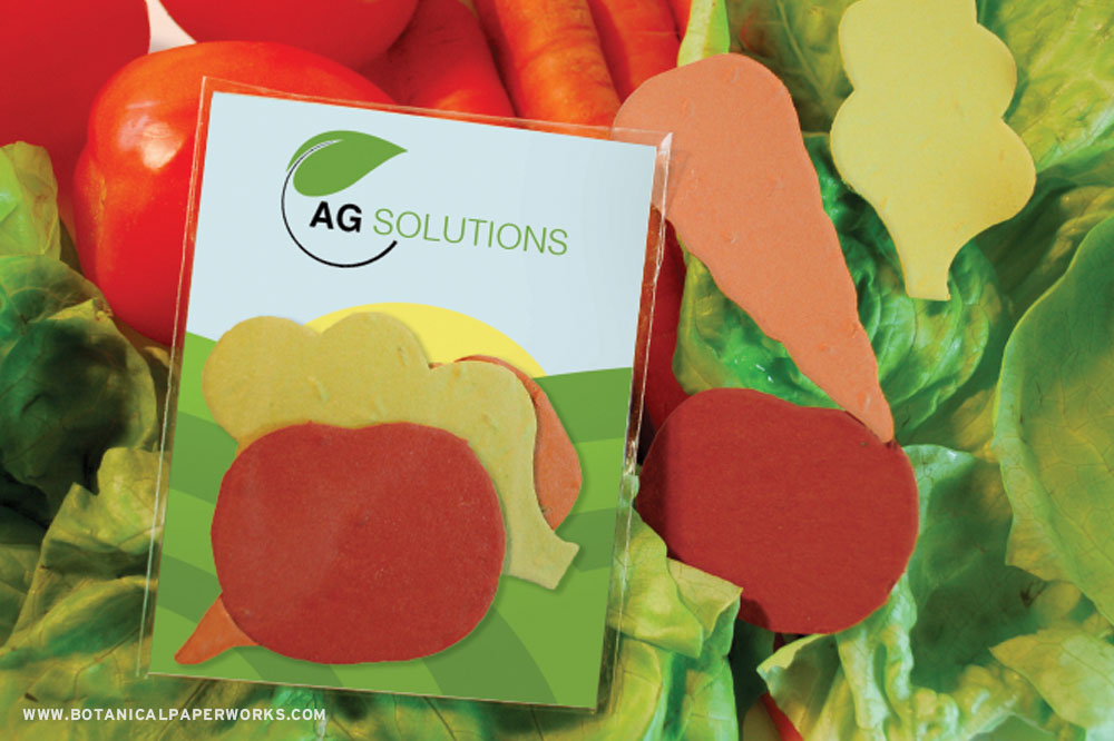 Seed paper shape pack surrounded by real veggies — a promotional product for the agriculture industry.