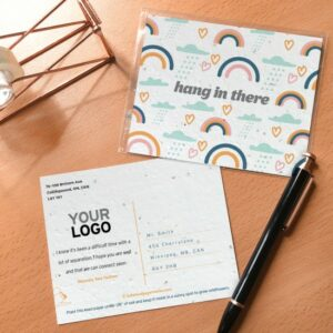 """Seed paper postcard with a graphic rainbow pattern and text that says """"hang in there"""""""