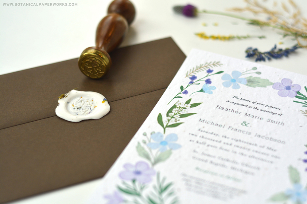 Seed paper wedding invitations with a was sealed envelope