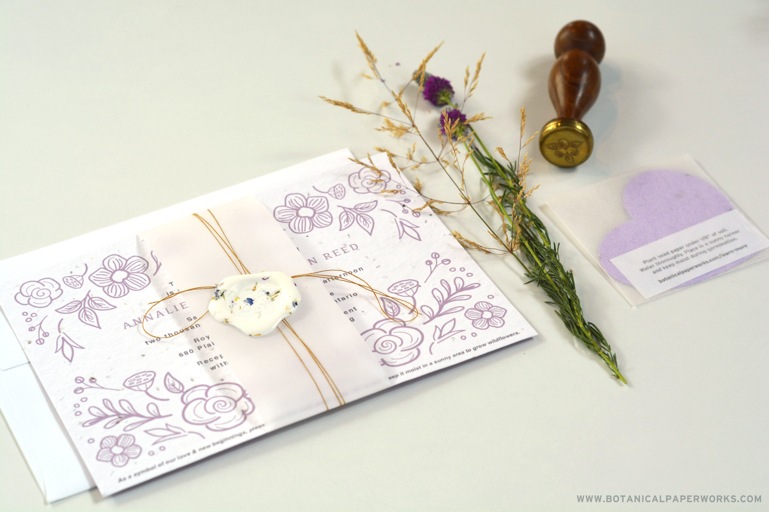 wax seal with dried wildflowers on seed paper wedding invite