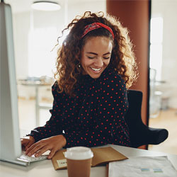 Woman at desk smiling