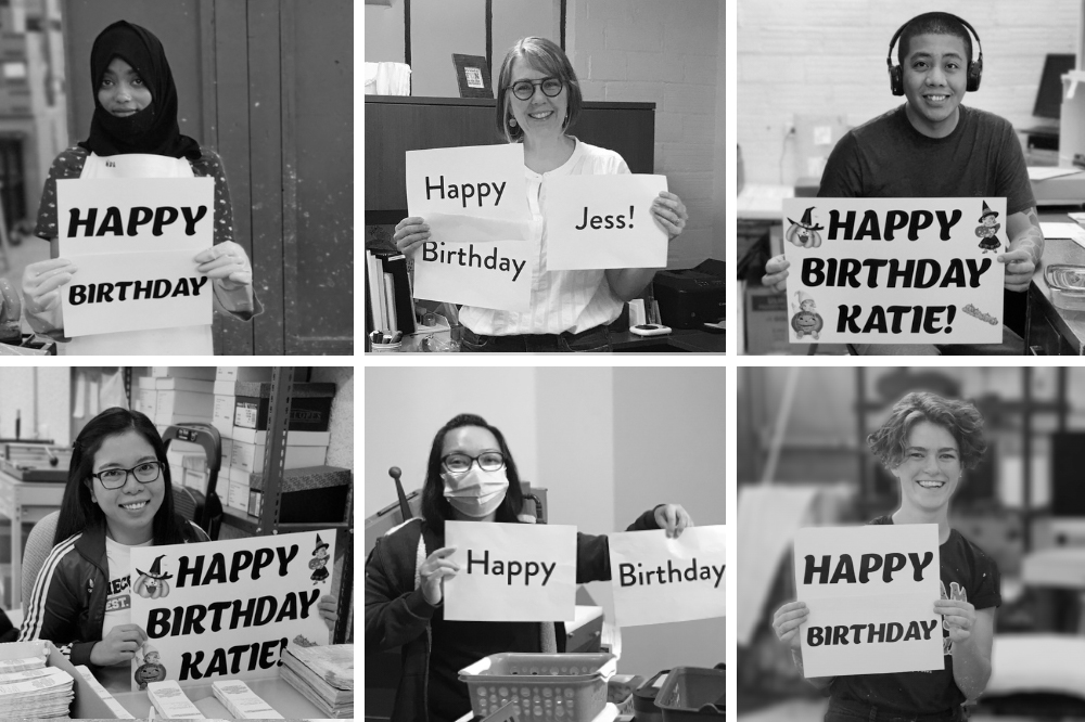 Botanical PaperWorks team members holding up 'Happy Birthday' signs.