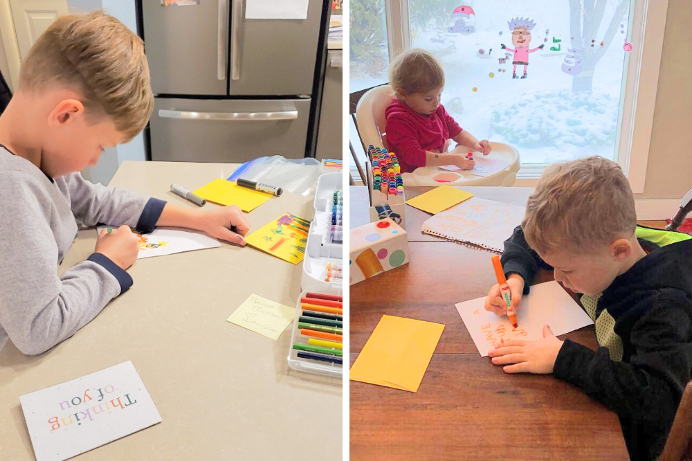 Kids sign Thoughtful Plantable Seed Paper Card Sets to send to seniors in long-term care homes
