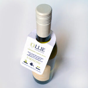 A wine bottle shown with a seed paper bottle neck tag.