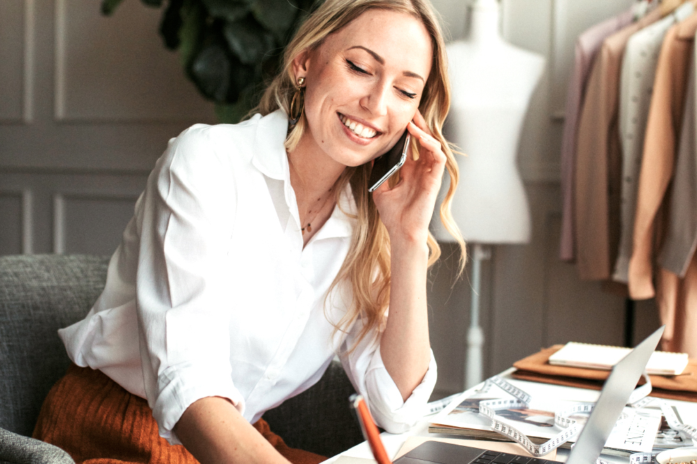 a bridal salon owner calling a client