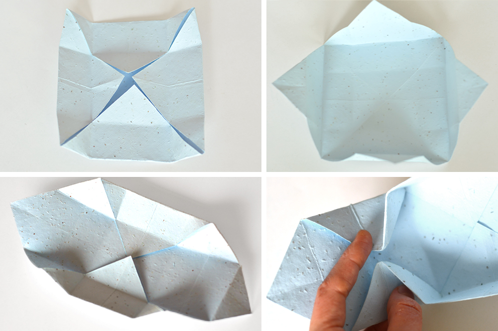 Folding pastel blue seed paper in an origami way for a DIY gift box that's eco-friendly