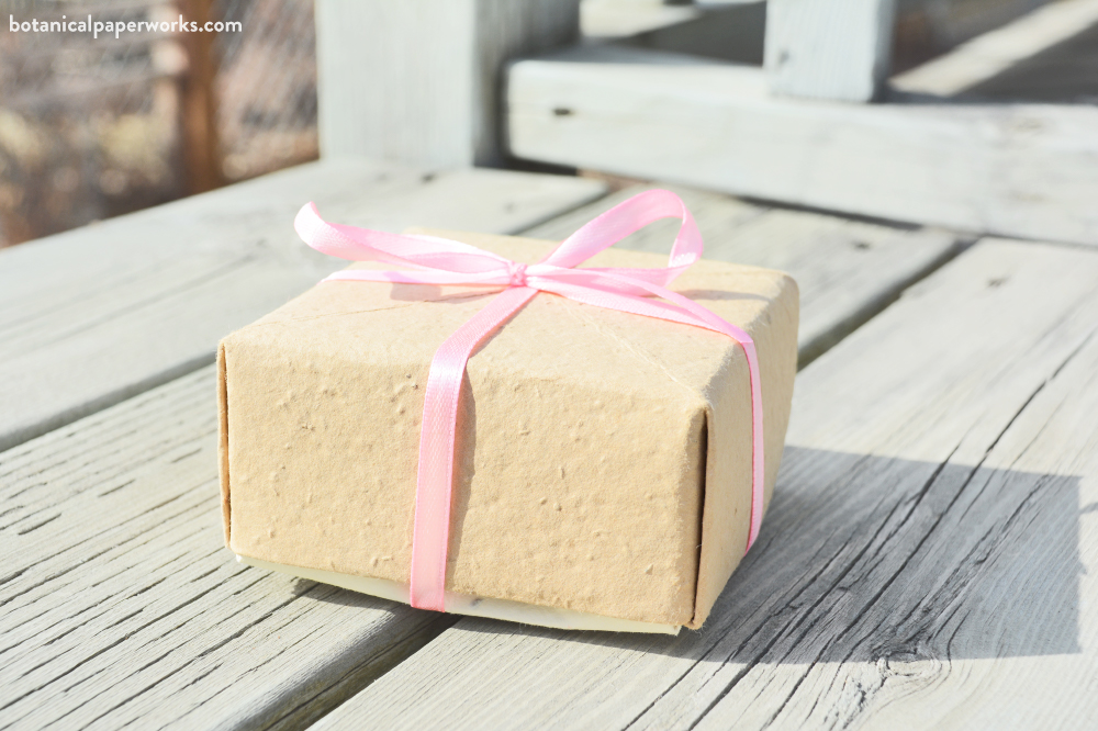 plantable seed paper gift boxes tied with ribbon and string in an eco-friendly way