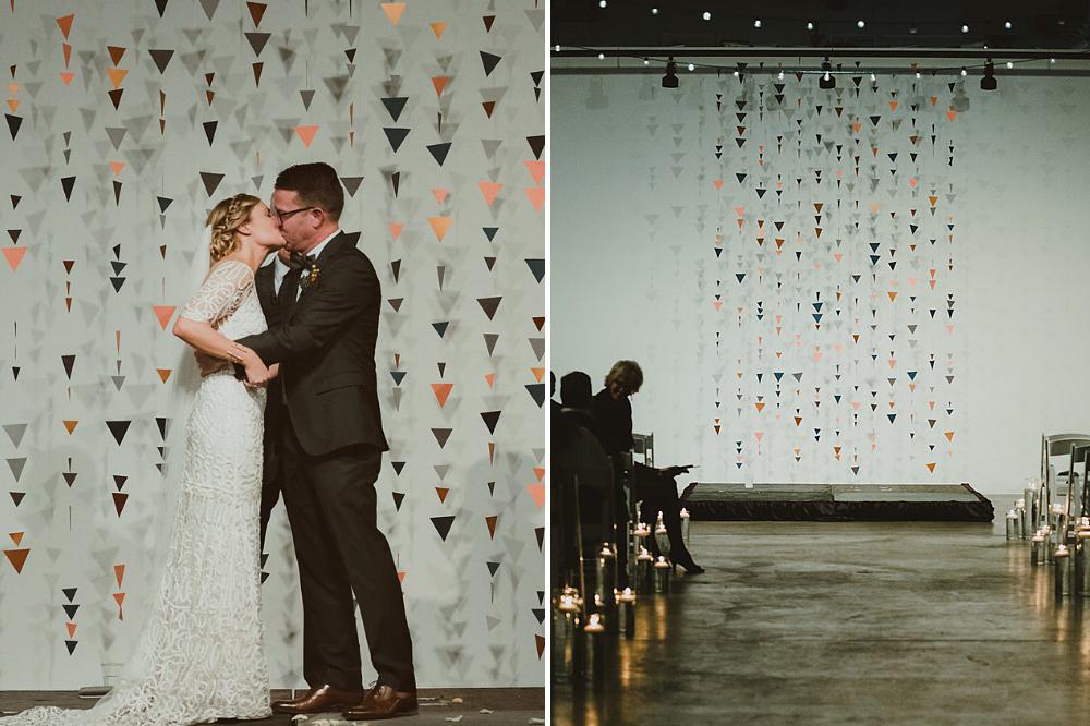 hanging paper triangles DIY wedding backdrop