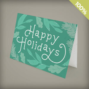 Seed paper business holiday cards with lush greenery dusted with snow