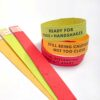 Color-coded social cues wristbands made with seed paper shown on white background.