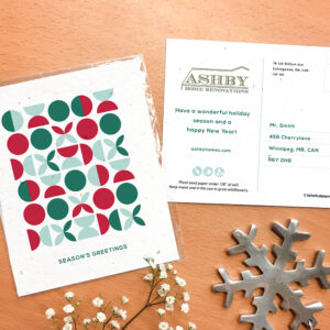 A seed paper postcard with a geometric pattern design in festive colors.