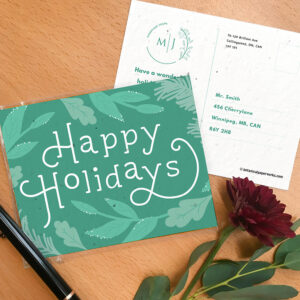 Seed paper postcard with greenery design and Happy Holidays typography