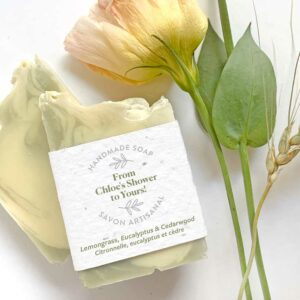 Handmade soap shower favors featuring a personalized message on a plantable seed paper belly band.