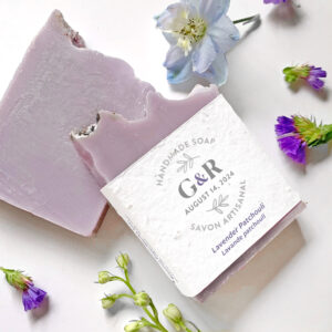 Beautiful handmade soap wedding favors featuring the couple initials and wedding date on a plantable seed paper belly band.