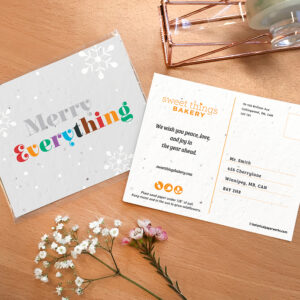 Seed paper postcard with a Merry Everything message in colorful lettering.
