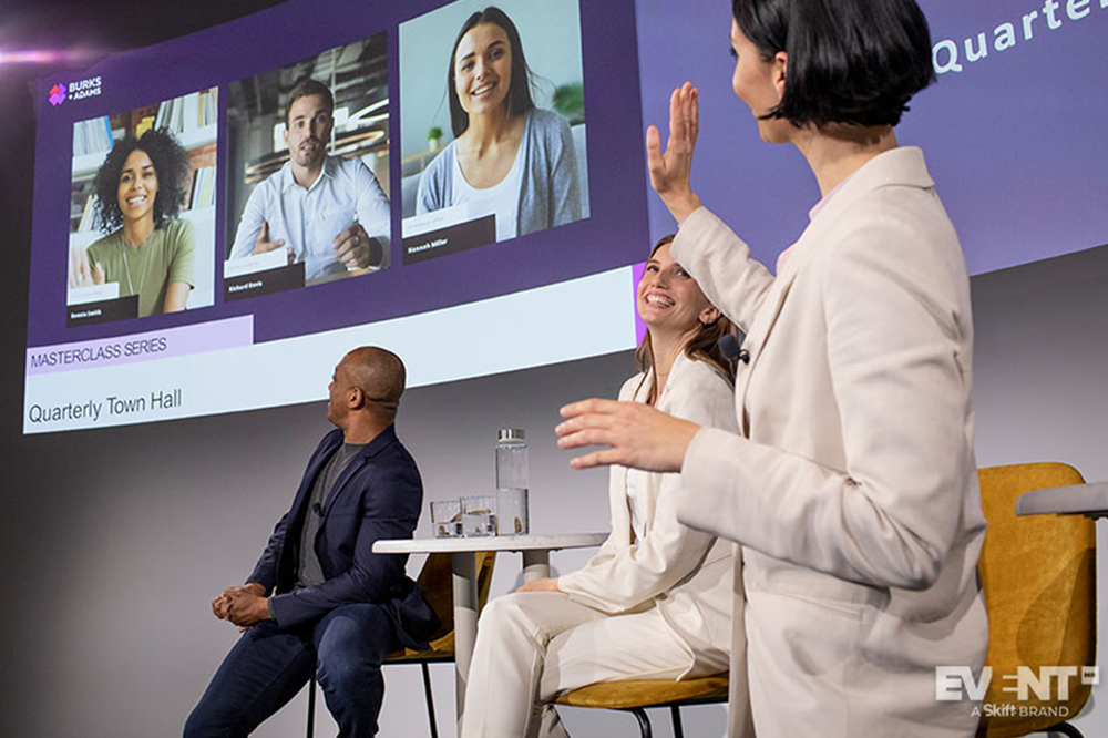 a hybrid event where a panel speaker has a video chat with other speakers