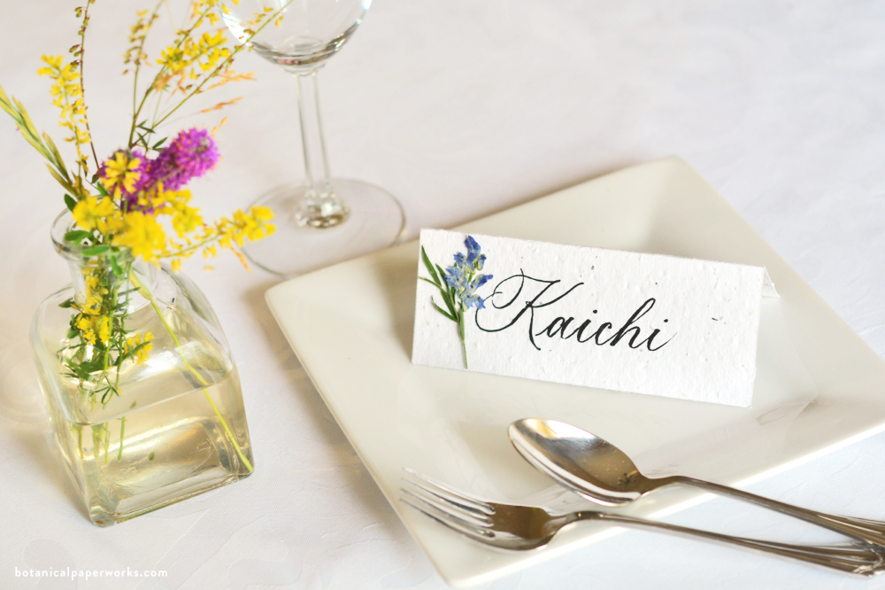 plantable seed paper place cards with dried wildflowers and calligraphy