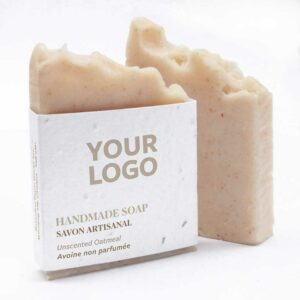 A bar of unscented oatmeal handmade promotional soap with a seed paper wrap featuring your logo.