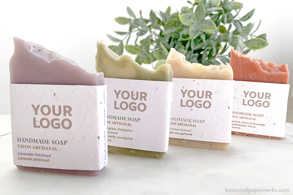 handmade promotional soaps in four different scents including lemongrass, eucalyptus and cedarwood; uscented oatmeal; lavendar patchouli; and grapefruit, lemon and rosemary