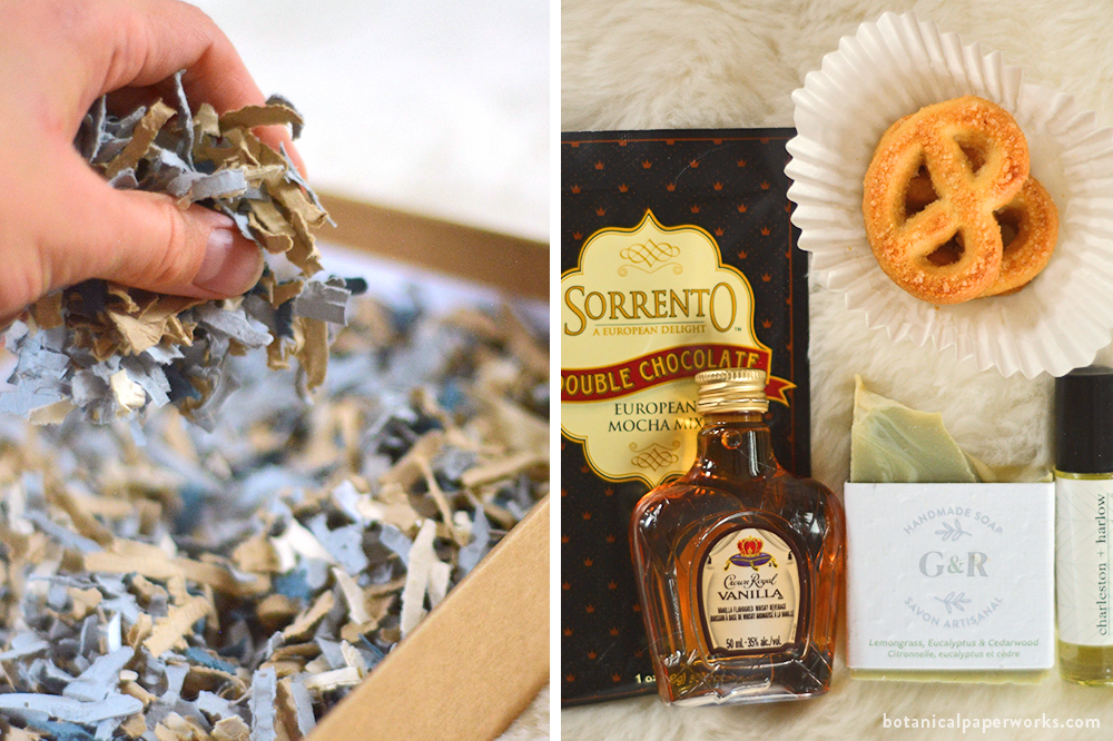 wedding welcome box with a seed paper thank you card, seed paper box filler, hot chocolate, perfume oil, liquor, handmade soap, and cookies