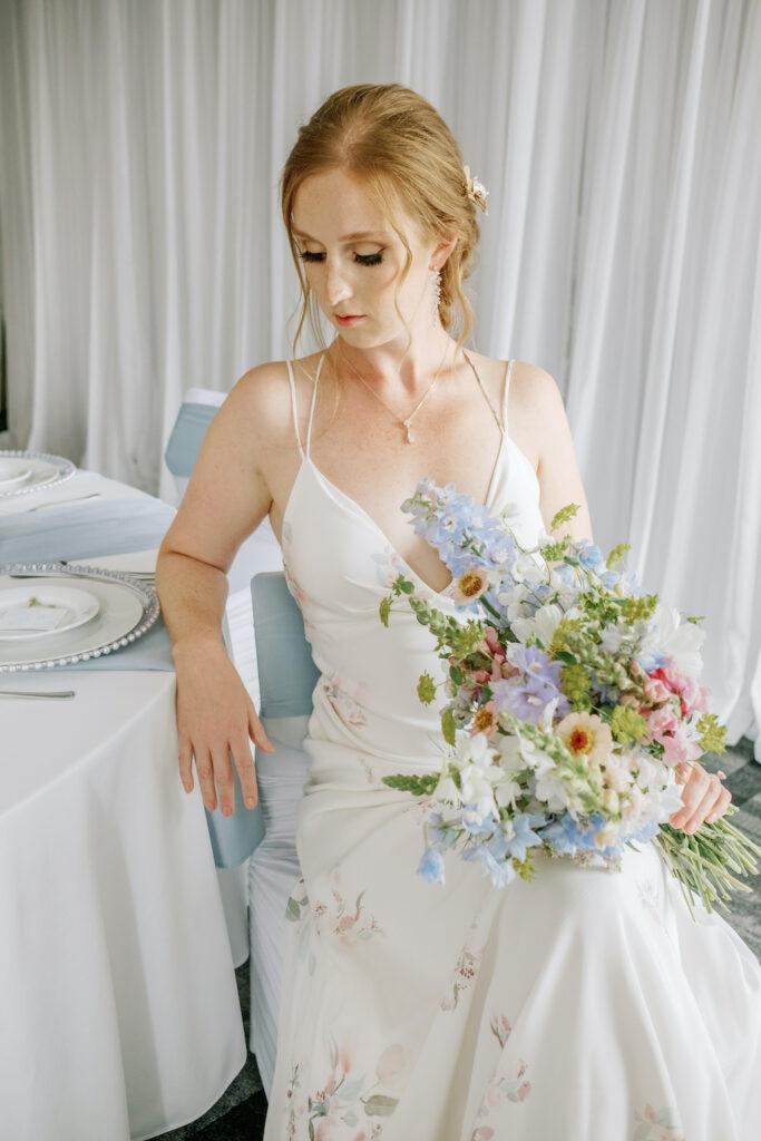 a bride holding her wedding bouquet