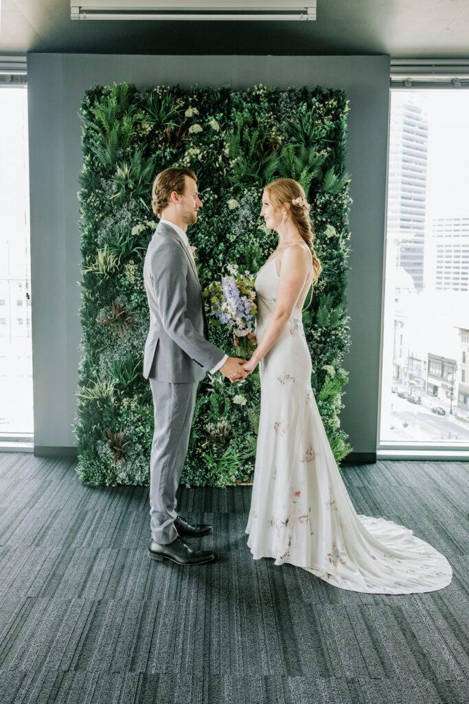 a verdant greenery wedding backdrop at an urban hotel venue