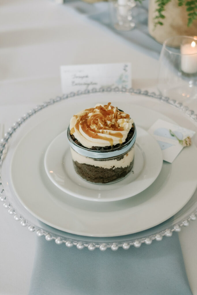 a wedding cake covered in caramel in a jar for one person
