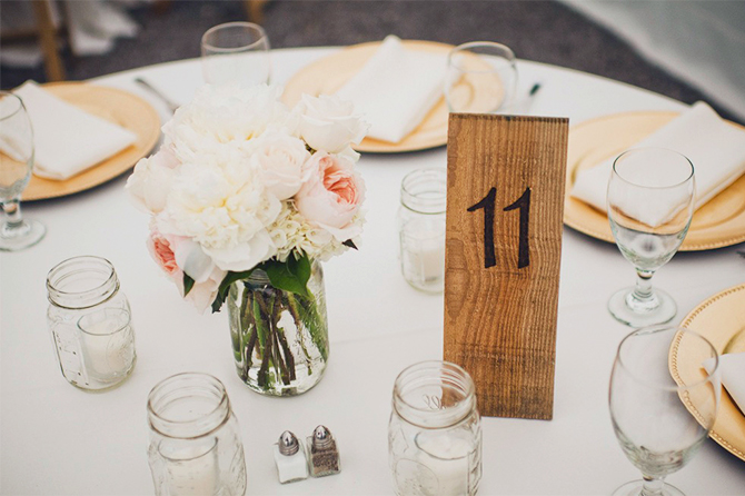 Up-cycle some old wood or wooden shingles into DIY table numbers.