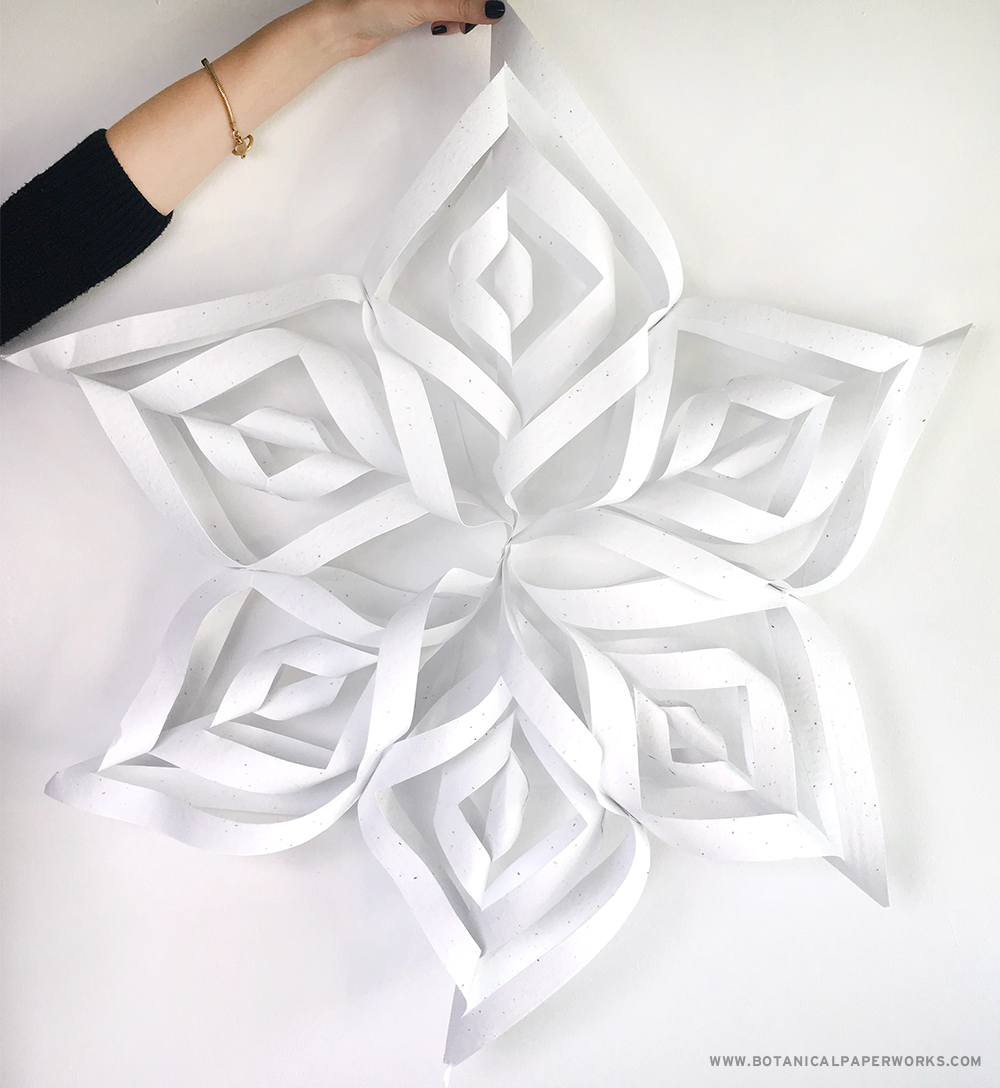 The 3D paper snowflakes are made with zero-waste seed paper!