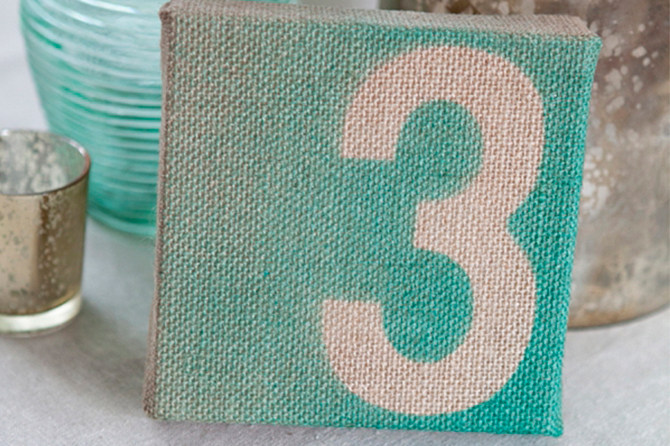Make these unique burlap canvas DIY table numbers with some number stencils and paint for a more crafty look and feel.