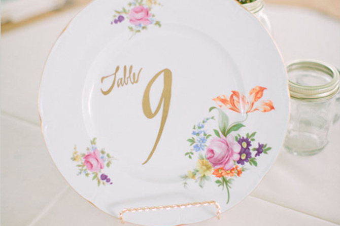 Turn vintage plates into stunning DIY table numbers with some metallic crafting paint.