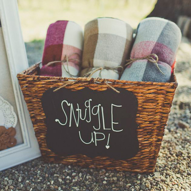 We love the idea of providing guests with cozy blankets for your #fallwedding! See more of our favorite details now. #weddings