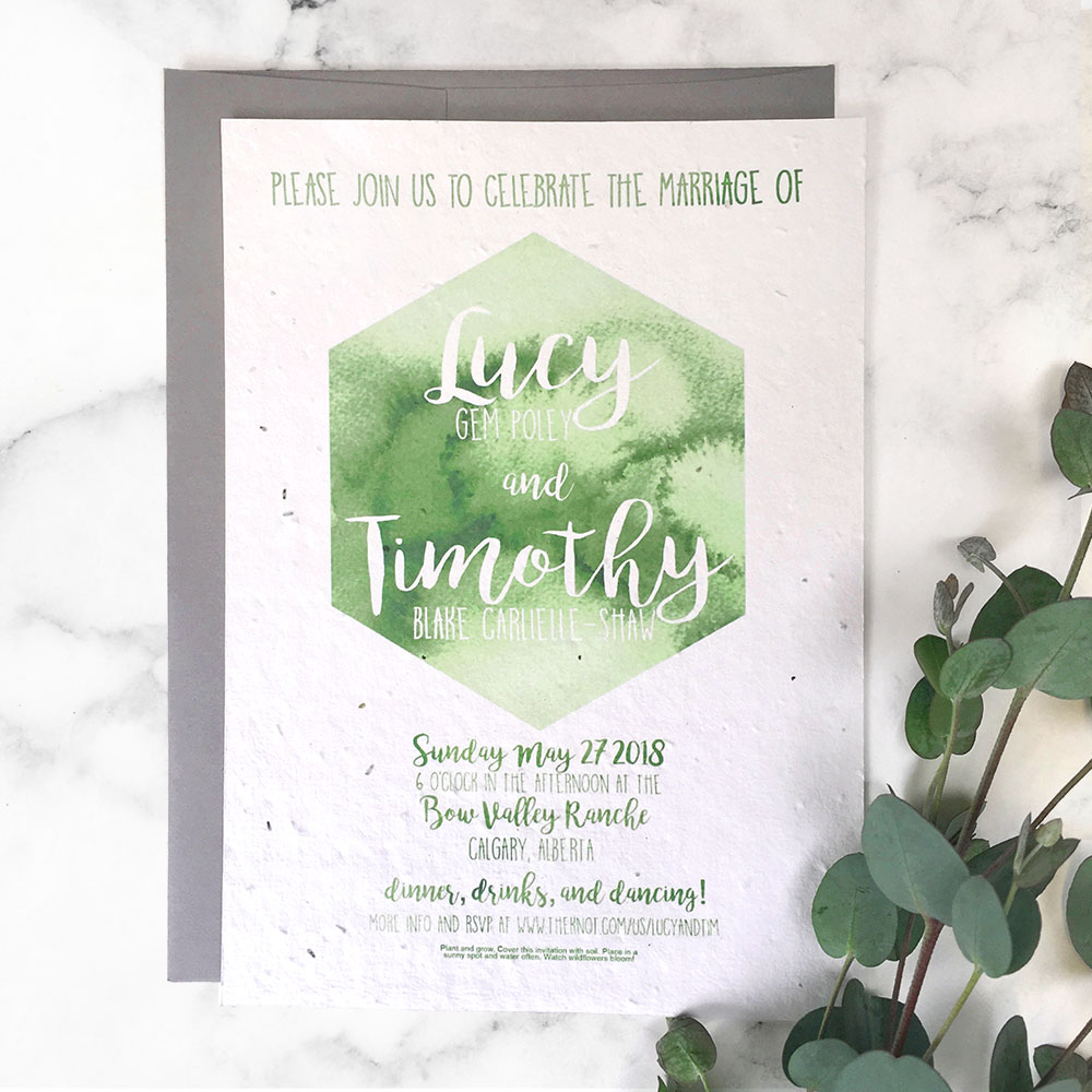 This unique Watercolour Hexagon Wedding Invitation is custom printed on seed paper from Botanical PaperWorks so it will grow when planted in soil. No waste, just wildflowers!