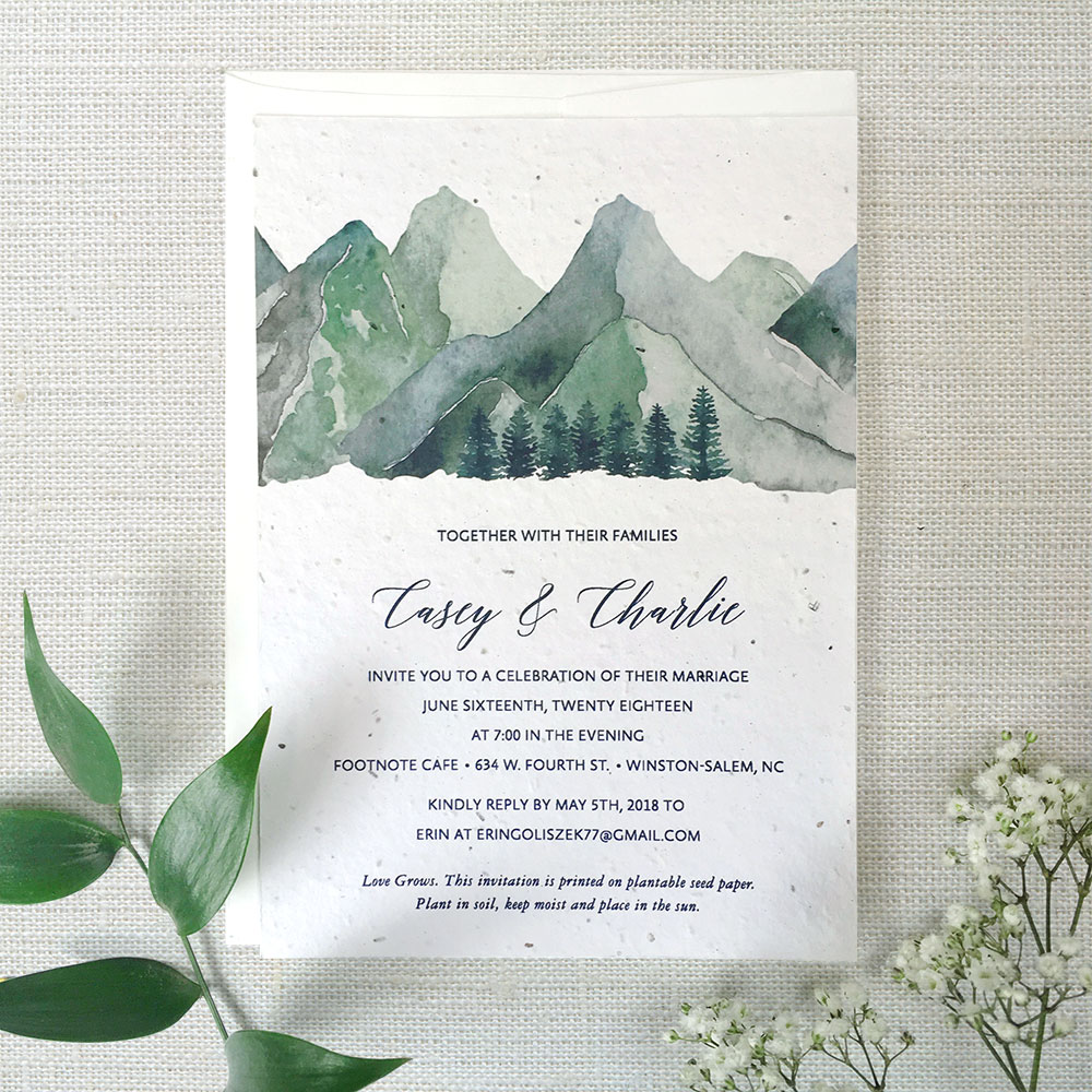 This unique Watercolour Mountain Wedding Invitation is custom printed on seed paper from Botanical PaperWorks so it will grow when planted in soil. No waste, just wildflowers!