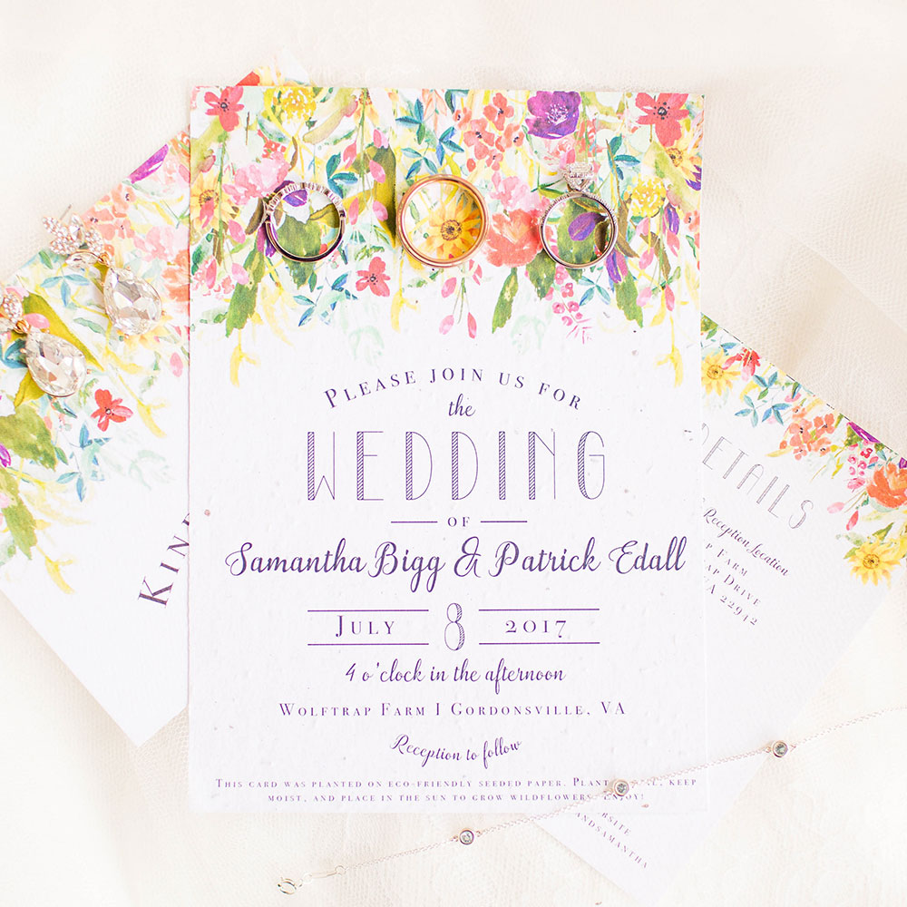 This blooming Wildflower-inspired Wedding Invitation is custom printed on seed paper from Botanical PaperWorks so it will grow when planted in soil. No waste, just wildflowers!