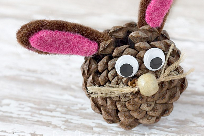 Get inspired by tons of Easter craft project ideas including these adorable pine cone bunnies.