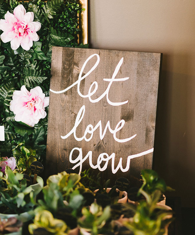This pretty Let Love Grow sign is perfect for a garden party wedding!